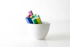 Bunch of square colorful pastel chalks in white bowl Royalty Free Stock Images