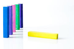 Bunch of standing square colorful pastel chalks with one lying down Stock Photos