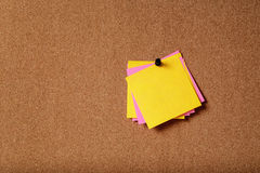 Bunch of sticky notes on cork board Royalty Free Stock Images