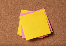 Bunch of sticky notes on cork board Stock Images