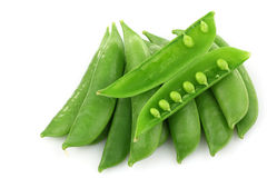Bunch of sugar snaps with one opened pod Royalty Free Stock Photos