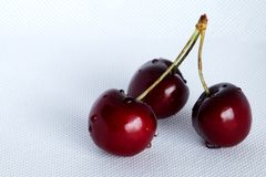 Bunch of sweet cherries on a white cloth royalty free stock photography