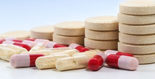Bunch of tablets and probiotics and antibiotics capsules stock images