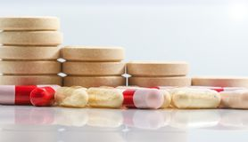 Bunch of tablets and probiotics and antibiotics capsules on whit royalty free stock images