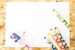Bunch of thick colorful pencils for children and sharpener with shavings Royalty Free Stock Photography
