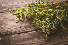 Bunch of thyme on the old wooden board horizontal Stock Photo
