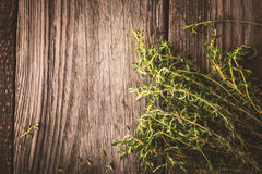 Bunch of thyme on the old wooden board top view Royalty Free Stock Image