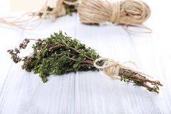 Bunch of thyme on table, close up Stock Image
