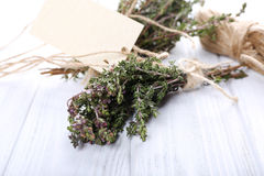 Bunch of thyme on wooden table Stock Photos
