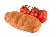 Bunch of tomatoes and bread Royalty Free Stock Photography