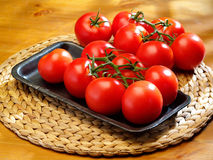 The bunch of tomatoes on a table. The bunch of fresh tomatoes on a table royalty free stock photo