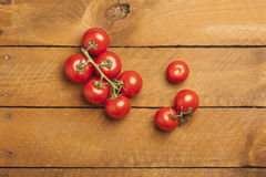 Bunch tomatoes on wood Stock Images