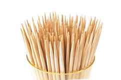 Bunch toothpicks in the cup. A lot of toothpicks in the cup. On a white background Stock Image