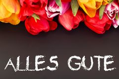 Bunch of tulips with blackboard: all the best in German language Stock Photos