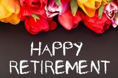 Bunch of tulips with blackboard: happy retirement