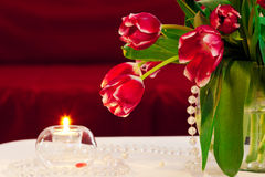 Bunch of tulips with candle Royalty Free Stock Image