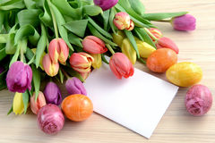 Bunch of tulips with easter eggs and note paper Royalty Free Stock Image
