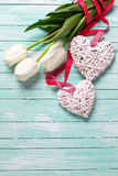 Bunch of tulips flowers and  two decorative hearts Stock Images