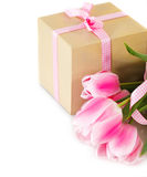 Bunch of tulips with gift box Stock Photos