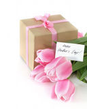 Bunch of tulips with present cart and gift box Royalty Free Stock Photos