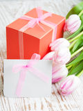 Bunch of tulips with present cart and gift box Royalty Free Stock Photo