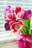 Bunch of tulips on the windowsill Stock Image