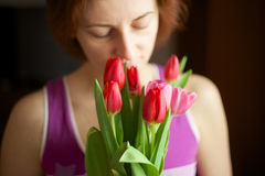 Bunch of tulips in woman hands. Stock Photography