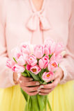 Bunch of tulips in woman's hands. Stock Image