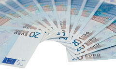 Bunch of twenty euro bills. Closeup of a bunch of twenty euro bills (isolated on white Royalty Free Stock Photos