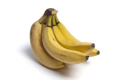 Bunch of unpeeled bananas Stock Images