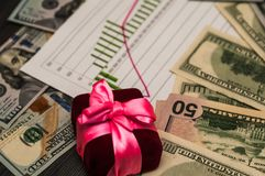 A bunch of US dollars in a pink ribbon, a beautiful background. stock photography