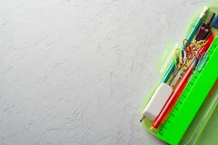 Bunch of various stationery lying on white plaster background.  royalty free stock images