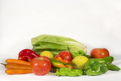 Bunch of vegetables and fruits with blank space at top. Different vegetables and fruis such as tomatoes, carrots, red and green peppers, lettuces and  lemons Royalty Free Stock Images