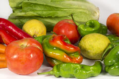 Bunch of vegetables and fruits. Different vegetables and fruis such as tomatoes, carrots, red and green peppers, lettuces and  lemons Stock Photography