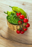 bunch of vegetables in the wooden bowl Stock Images
