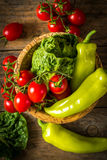 bunch of vegetables in the wooden bowl Royalty Free Stock Photos