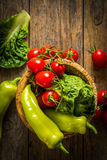 bunch of vegetables in the wooden bowl Stock Photography