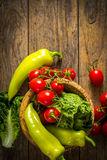 bunch of vegetables in the wooden bowl Royalty Free Stock Images