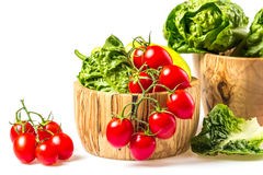 bunch of vegetables in the wooden bowl Stock Photos
