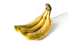 Bunch of very ripe bananas isolated on white royalty free stock photo