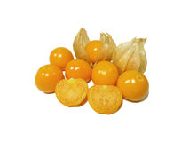 Bunch of vibrant yellow ripe Cape gooseberries, some with calyx, some cut in half. Isolated on white background Stock Photos