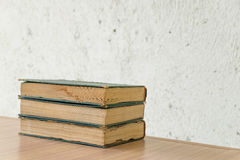 Bunch of vintage books on wooden table Royalty Free Stock Image