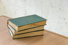 Bunch of vintage books on wooden table Stock Image