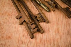 Bunch of old keys. Bunch of vintage oxidized keys with a strong patina Stock Photos