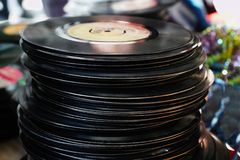 A bunch of vinyl records stacked in a flea market stock images