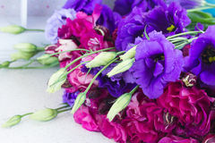 Bunch of  violet and mauve  eustoma flowers. Bunch of violet and mauve  eustoma flowers  on table Stock Images