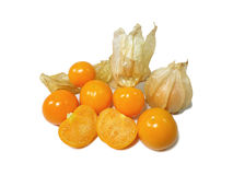 Bunch of vivid yellow ripe Cape gooseberries, some with calyx, some whole, some cut in half. Isolated on white background Royalty Free Stock Image
