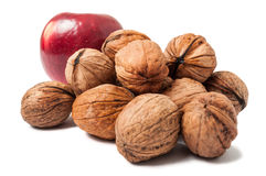 Bunch of walnuts and an apple Stock Photos