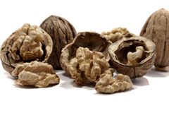 Bunch of walnuts. Close view detail of  some walnuts  isolated on a white background Stock Images
