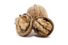 Bunch of walnuts. Close view detail of some walnuts isolated on a white background Royalty Free Stock Photos